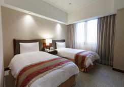 人道国际酒店 - 高雄市 - 睡房