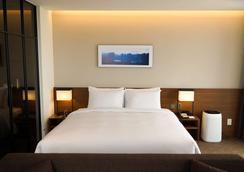 海云台华美达安可酒店 - 釜山 - 睡房