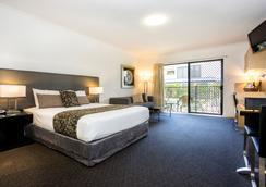 珊瑚岛度假村汽车旅馆 - 麦凯 - 睡房