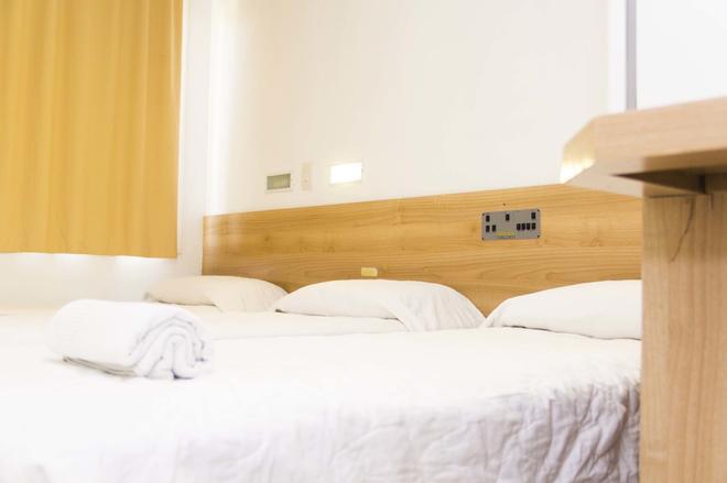 美努亚诺之家酒店 - 阿雷格里港 - 睡房