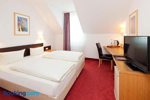 伽登乡村小别墅公寓式酒店 - 德累斯顿 - 睡房