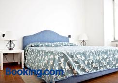 米拉拉格住宿加早餐旅馆及公寓式酒店 - 贝拉吉奥 - 睡房