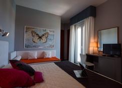 大都会酒店 - 西尼加利亚 - 睡房