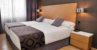 环球酒店 - 圣地亚哥-德孔波斯特拉 - 睡房