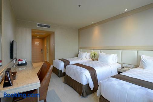 阿里亚泗水中央酒店 - 泗水 - 睡房
