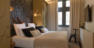 里昂玫瑰旅行酒店 - 里昂 - 睡房