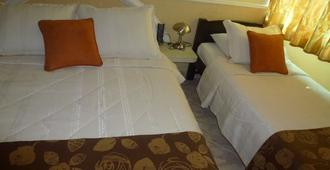 圣尼古拉斯酒店 - 布卡拉曼加 - 睡房