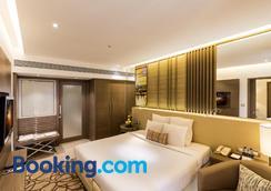 度假酒店 - 孟买 - 睡房