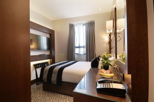 贝斯特韦斯特沙夫茨伯里帕丁顿法院伦敦酒店 - 伦敦 - 睡房