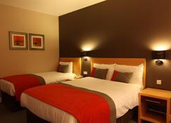 城市酒店 - 伦敦德里 - 睡房