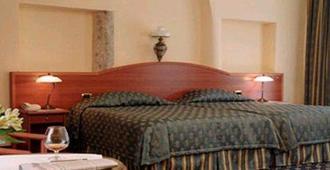 维尔纽斯黎明门皇家精品酒店 - 维尔纽斯 - 睡房