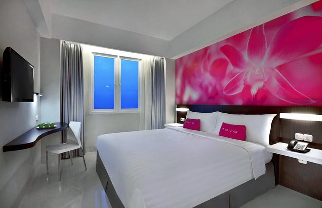 桑努尔阿里芬加达玛达菲芙酒店 - 雅加达 - 睡房