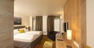 高登尼斯拉得酒店 - 乌尔姆 - 睡房