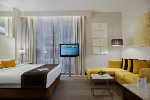 巴莎中心酒店 - 迪拜 - 睡房