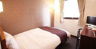 一区鹿儿岛酒店 - 鹿儿岛 - 睡房