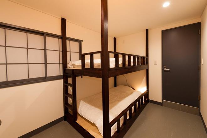 六本木英诺家庭经营旅舍 - 东京 - 睡房