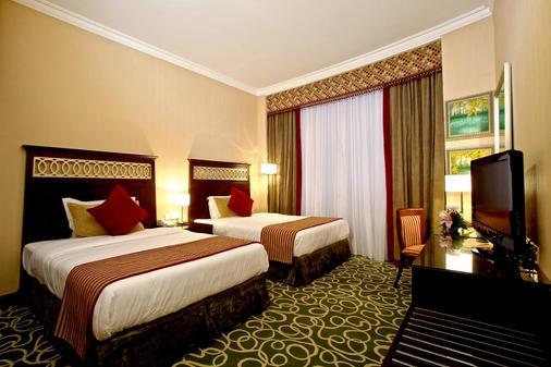 富查伊拉康科德酒店 - 富查伊拉 - 睡房