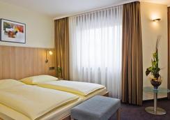 柏丽娜霍夫城市伙伴酒店 - 卡尔斯鲁厄 - 睡房