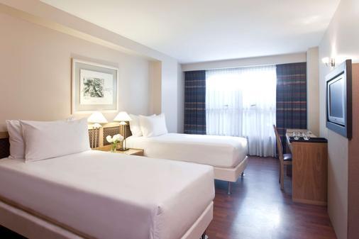 科尔多瓦乌尔巴诺nh酒店 - 科尔多瓦 - 睡房