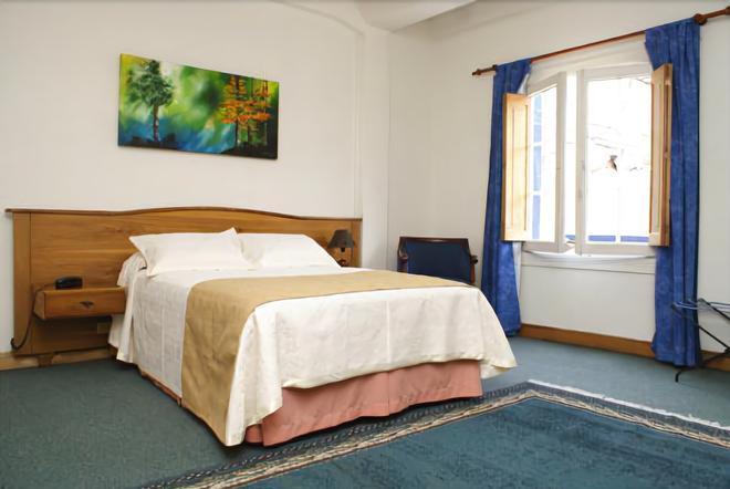 埃斯科里亚尔酒店 - 马尼萨莱斯 - 睡房