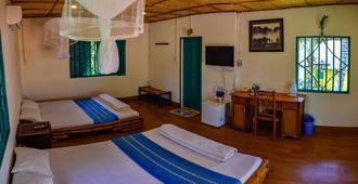 美奈热情南州精品度假村 - 潘切 - 睡房