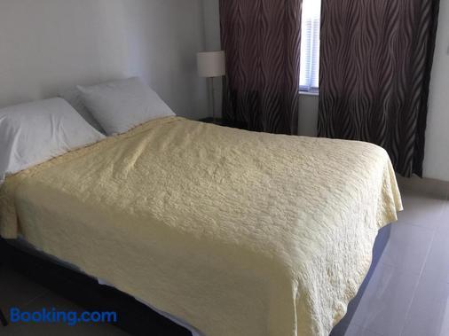 海滨鹈鹕酒店 - 帕诺滩 - 睡房