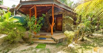悠活绿花园小屋酒店 - 坦加拉