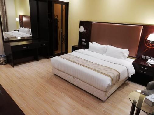 拉达哈伊勒酒店 - 多哈 - 睡房