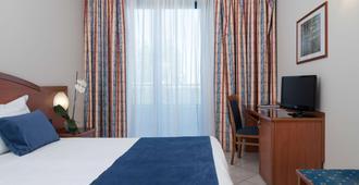 蓝色饭店 - 贝斯特韦斯特修尔住宿精选饭店 - 都灵 - 睡房