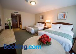 渴望旅馆套房酒店 - 利马 - 睡房