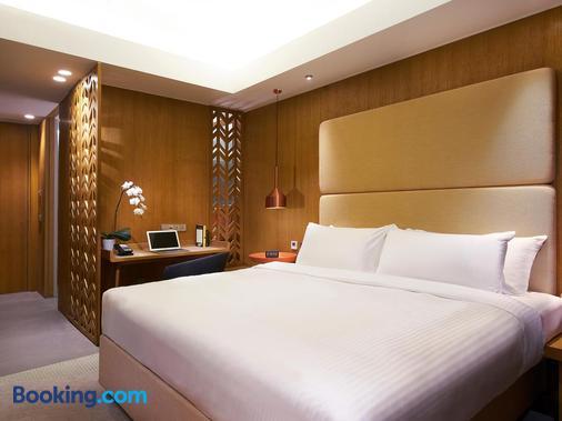 新加坡市中心绿洲酒店 - 新加坡 - 睡房