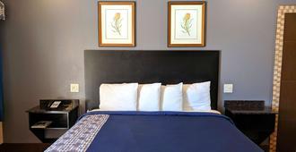 美国最佳价值旅馆 - 布朗斯维尔汽车旅馆 - 布朗斯维尔 - 睡房