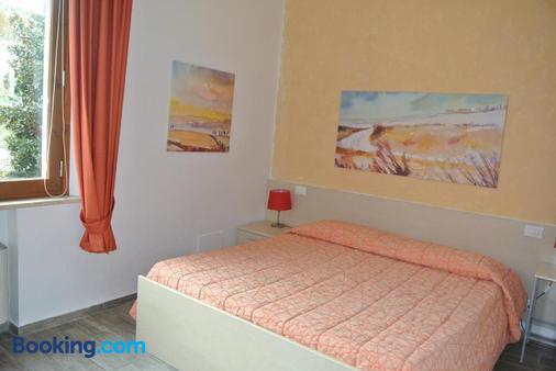 卡莫里亚食宿酒店 - 锡耶纳 - 睡房