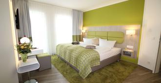皇帝大厅酒店 - 爱尔福特 - 睡房