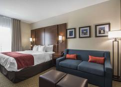 里贾纳舒适套房酒店 - 里贾纳 - 睡房
