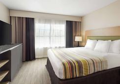 杰克逊机场丽怡酒店 - 珍珠城 - 睡房