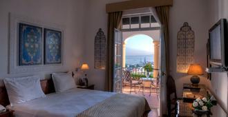 明萨酒店 - 丹吉尔 - 睡房