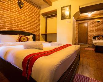 图拉亚精品酒店 - 巴克塔普尔 - 睡房