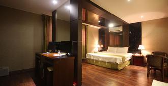 索诺酒店 - 庆州 - 睡房