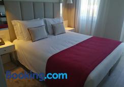 加拿大公寓式酒店 - 里斯本 - 睡房