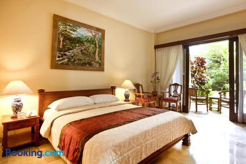 库玛拉潘泰酒店 - 库塔 - 睡房