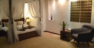 菲尼西亚舒适酒店 - 布加勒斯特 - 睡房