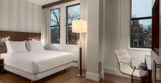 阿姆斯特丹市中心nh酒店 - 阿姆斯特丹 - 睡房