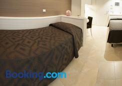 菲尼酒店 - 圣乔瓦尼·罗通多 - 睡房