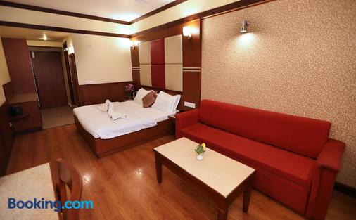 毗湿奴宫酒店 - 穆索里 - 睡房