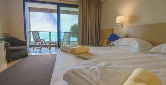 阿卡维瓦戴加尔达酒店 - 代森扎诺-德尔加达 - 睡房