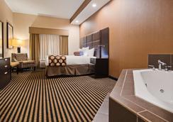 西佳plus阿特里亚机场套房酒店 - 平原镇 - 睡房