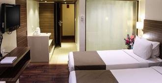 优质住宿公寓酒店 - 海得拉巴 - 睡房