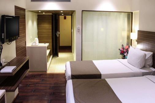 住宅品质酒店 - 海得拉巴 - 睡房