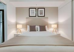 布里斯班佛特谷阿尔法马赛克酒店 - 布里斯班 - 睡房